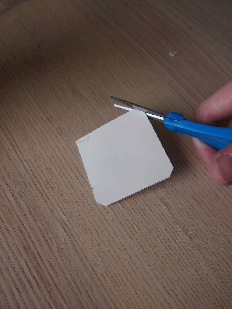 3     Slightly trim the edges of the square you just cut.