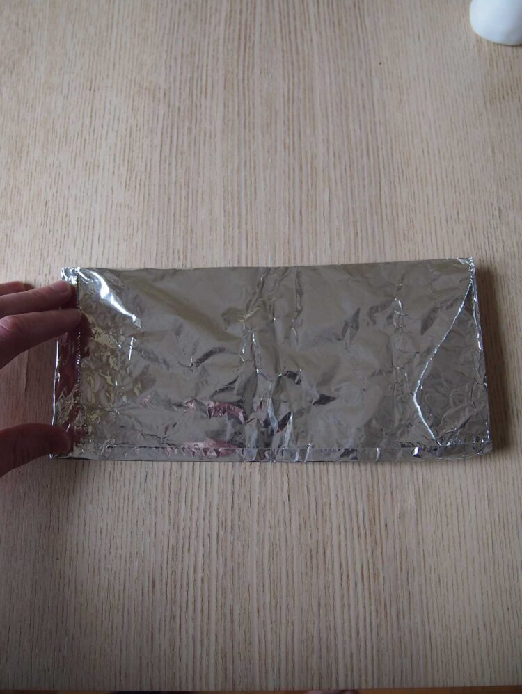 15     Fold heavy duty aluminum foil into a roughly 4in x 8in (10cm x 20cm) rectangle