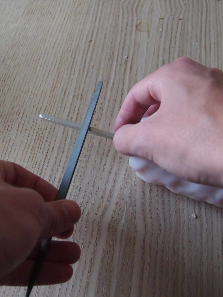 18   If you want a shorter mill, you can also cut the center metal piece with a metal file.
