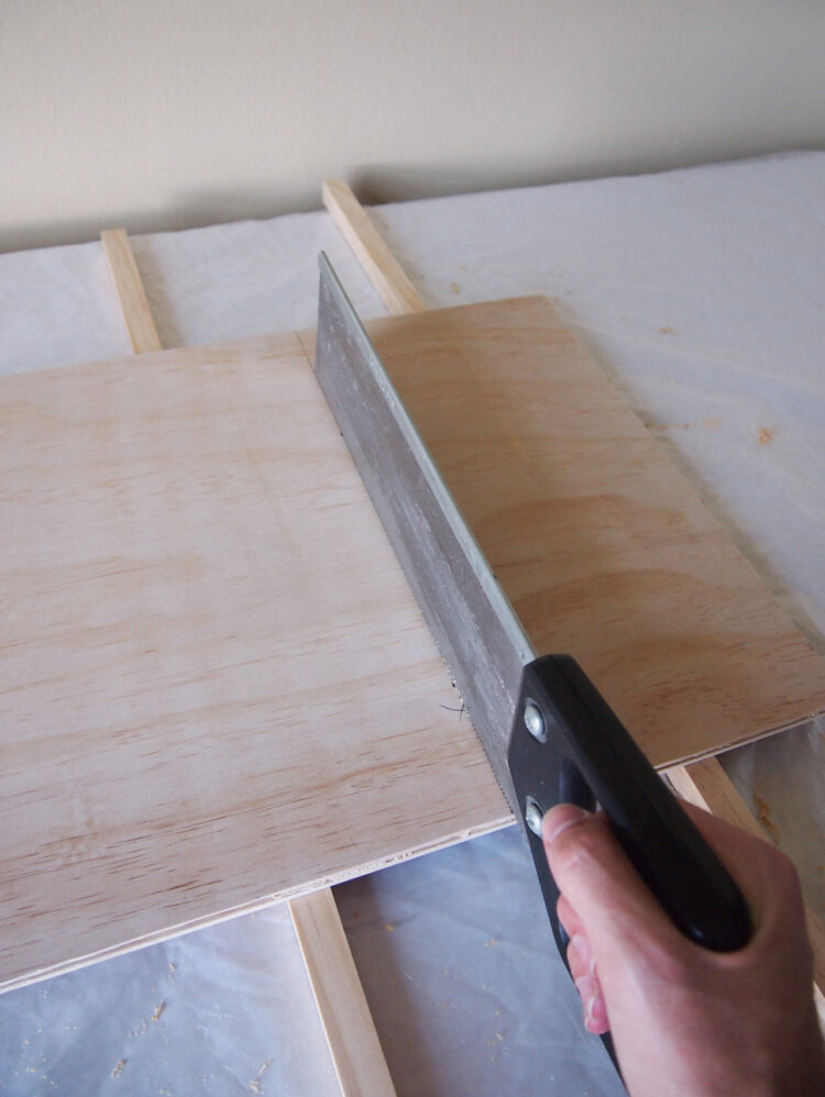 14     Measure and cut the following rectangles of 1/2in (12mm) thick plywood: 1 piece 18in x 15in (450mm x 380mm), 1 piece 10in x 15in (250mm x 380mm). Have these pre-cut at the store, if possible.